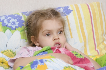 Four-year-old girl is in bed under the blanket Stock Photo - 20823006