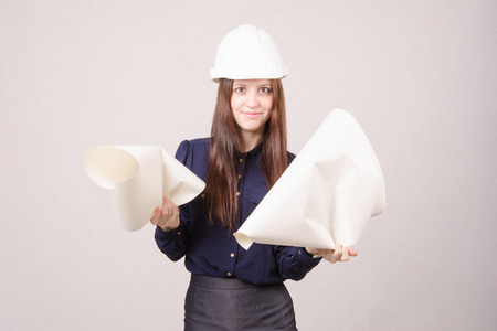 architect drawing: Young woman architect in helmet drawing tears Stock Photo