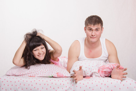 bitterness: Young couple disappointed missed chance lie in bed Stock Photo