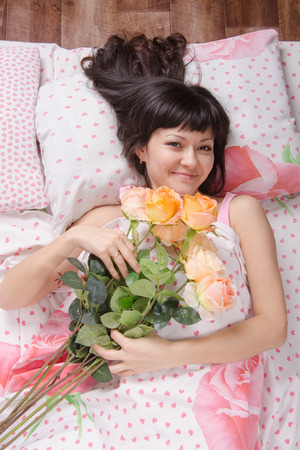 gave: A beautiful young girl who lies in bed, gave flowers