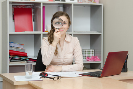 Young girl working at the desk in the office photo
