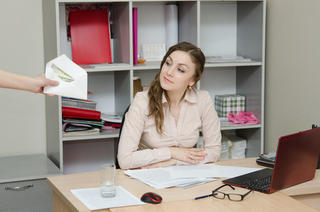 work took: Young girl working at the desk in the office Stock Photo