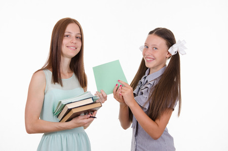 tutorials: School teacher and student holding a book and notebook