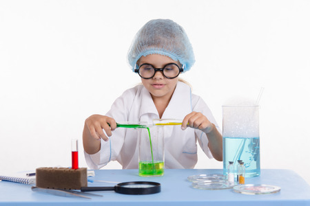 Girl sitting in chemistry class and makes the simplest experiments