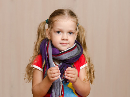 certain: The three-year girl with diseased scarf holding a certain object Stock Photo