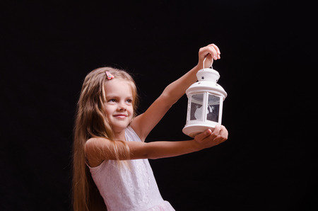 five year old: Five year old girl standing with a candlestick Stock Photo