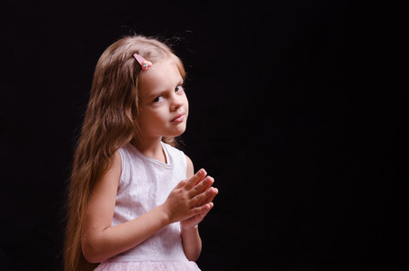 five year old: Portrait of a beautiful five year old girl on a black background