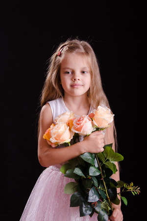 five year old: Portrait of a five year old girl with a bouquet of flowers on a black background