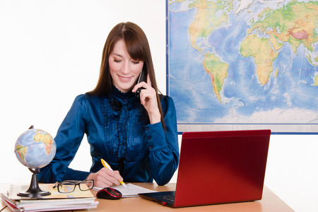 Young beautiful employee in the office of the travel agency Stock Photo