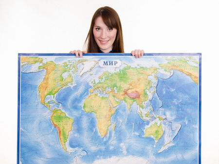 selling service smile: Beautiful young girl holding a map of the world Stock Photo