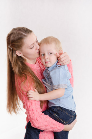 three year old: Young beautiful girl hugging her three year old son