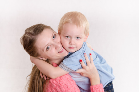 sooth: Young beautiful girl hugging his three sons Stock Photo