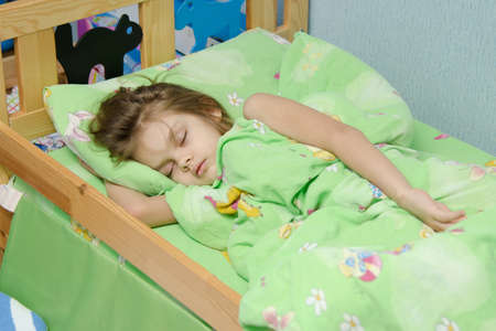 six year old: six year old girl Europeans sleeping in her bed Stock Photo
