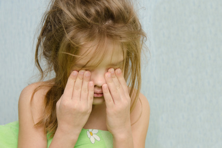 six year old: Six year old girl woke up early in the morning Stock Photo