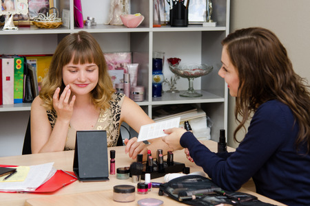 advertises: Beauty Consultants offers cosmetics client in the office