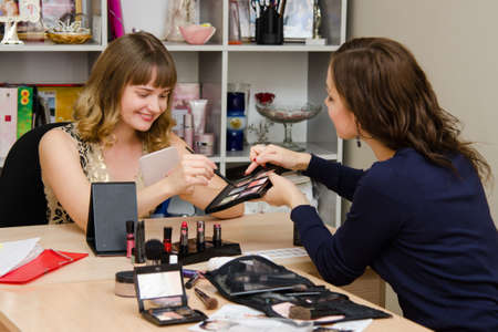 Beauty Consultants offers cosmetics client in the office