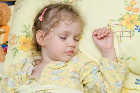 three year old: Three year old girl sweetly asleep in his crib in the nursery