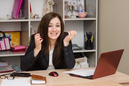 omission: Cute business woman in the office at the computer Stock Photo