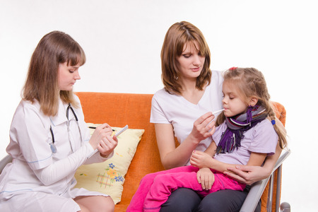 persuades: Doctor pediatrician examines a sick child at home in the presence of my mother