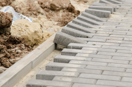 curb: Laying of paving slabs to the curb Stock Photo