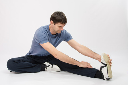 30 year old: thirty young athletic man does physical exercises Stock Photo