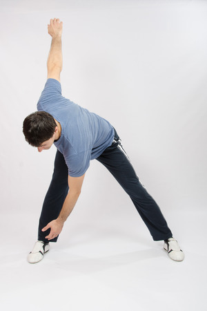 thirty: thirty young athletic man does physical exercises Stock Photo