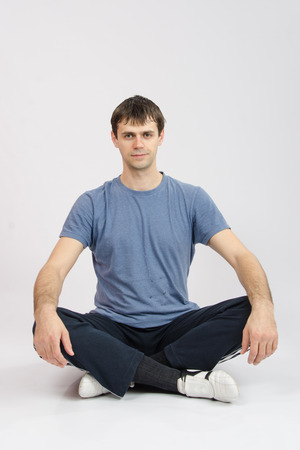 morally: thirty young athletic man does physical exercises Stock Photo
