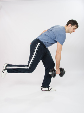 severity: thirty young athletic man does physical exercises Stock Photo