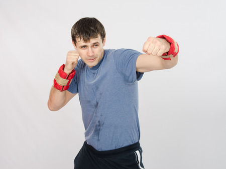 thirty young athletic man does physical exercises Stock Photo
