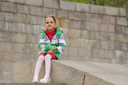 six years: A girl of six years walking on the embankment Stock Photo