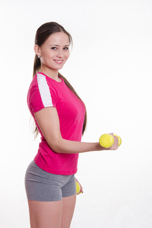 europeans: Young beautiful girl holds Europeans physical exercise