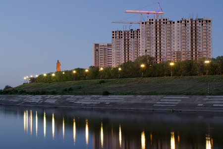 volgograd: Evening view of the residential complex under construction high-rise buildings on the waterfront of Krasnoarmeysk district of Volgograd
