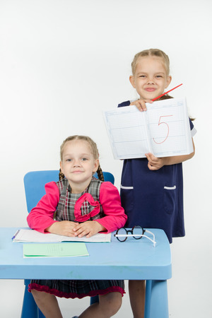 earned: Two girls play school teacher and student Stock Photo