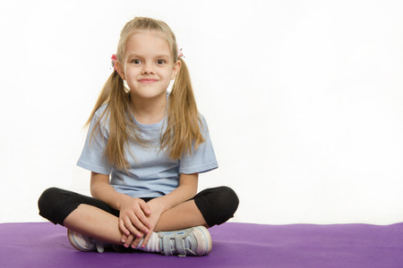 six girl: Six year old girl Europeans engaged in physical exercises