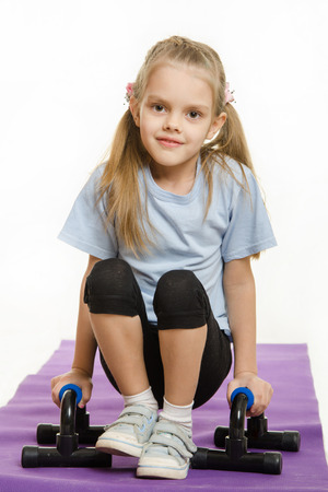 six year old: Six year old girl Europeans engaged in physical exercises