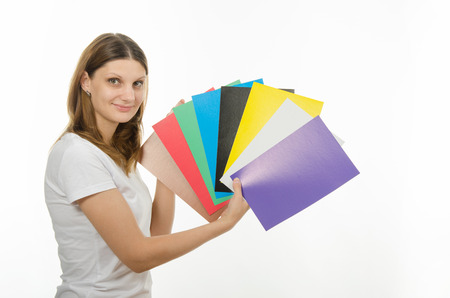blindness: Young beautiful girl holding a picture with solid colors Stock Photo