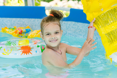 bathed: Six year old girl Europeans bathed in a small suburban pool