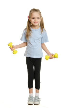 europeans: Four-year girl Europeans engaged in physical exercises Stock Photo