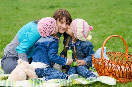 three year old: Incomplete family - mother, five-year and three year old daughter at a picnic Stock Photo
