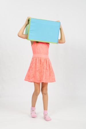 six year old: Six year old girl wearing a European-style box on his head, isolated on a light background