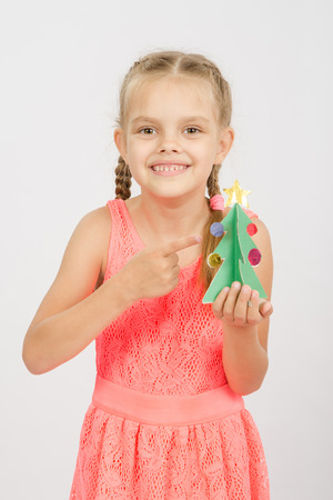 six year old: Six year old girl stands with crafts made of cardboard, isolated on a light background Stock Photo