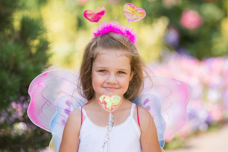 baby 4 5 years: Portrait of a fairy with a magic wand Stock Photo