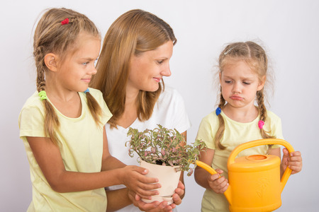 six years: Mother and two daughters, four and six years of caring and watering potted plants