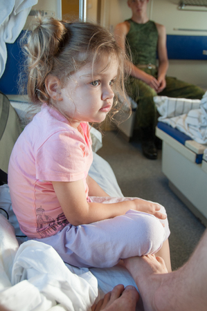 three year old: Sad three year old girl in the car with reserved seats