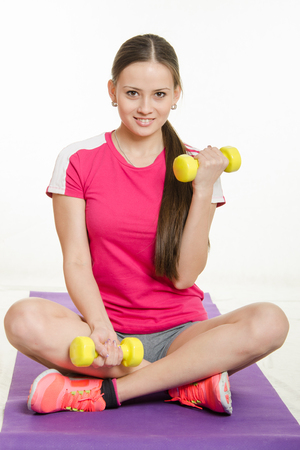 europeans: Young beautiful girl athlete Europeans conducting physical training