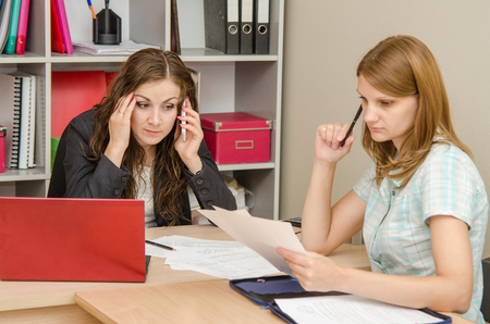 phone calls: Young beautiful girl on reception at the office specialist