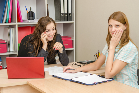anecdote: Young beautiful girl on reception at the office specialist
