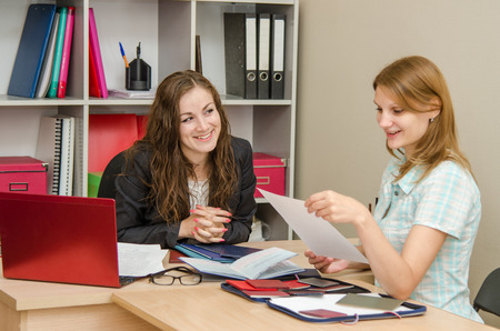 interview: Young beautiful girl on reception at the office specialist