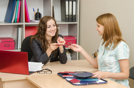 job qualifications: Young beautiful girl on reception at the office specialist