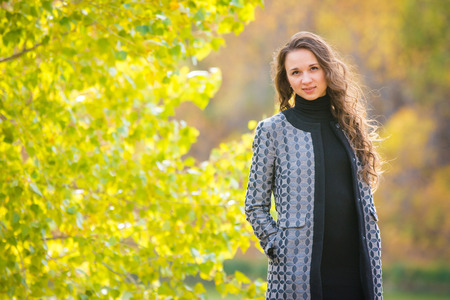 europeans: Twenty-five young beautiful girl walks by Europeans autumn forest Stock Photo